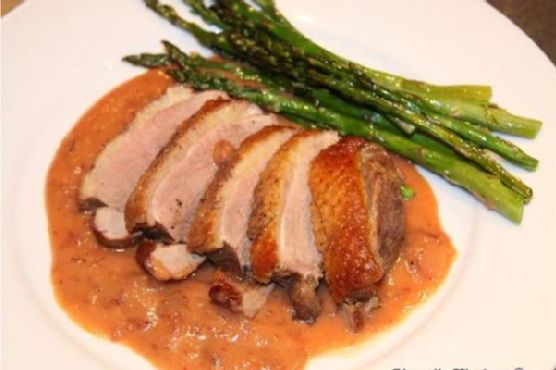 Duck with Dried Cranberries, Tangerines and Mascarpone Sauce