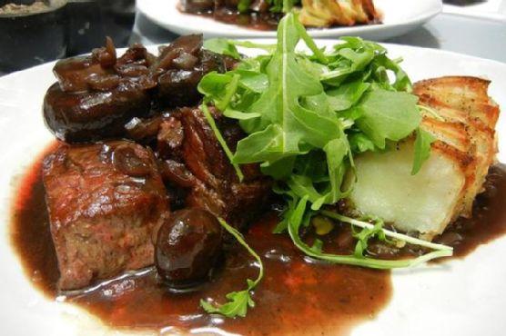 Kobe Sirloin Tips In Mushroom Wine Sauce With Duck Fat Potato Dominoes and Rocket