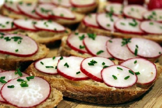 Sliced Baguette with Anchovy Chive Butter and Radishes