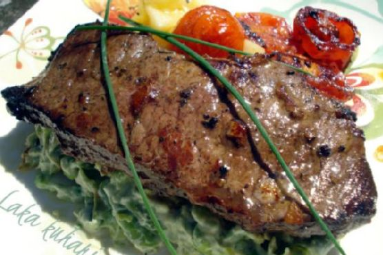 Strip steak with roasted cherry tomatoes and vegetable mash