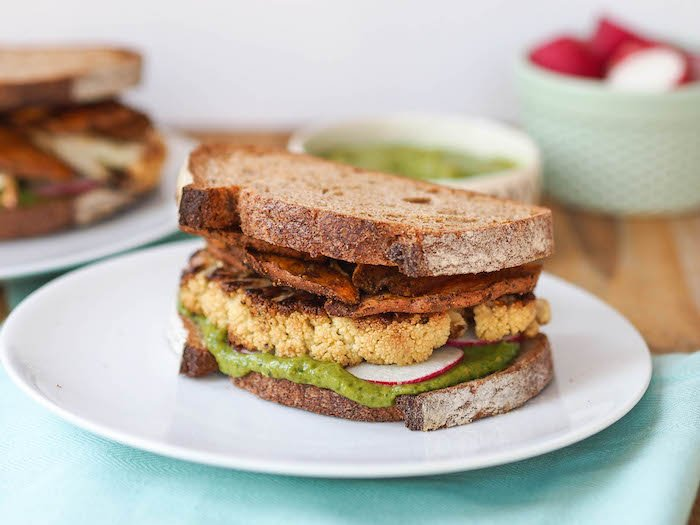 Roasted Cauliflower Sandwich with Spicy Sweet Potato Chips and Creamy Cilantro Avocado Sauce